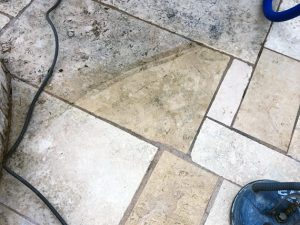 Stained limestone pool surround